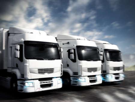 szállítás: Három fehér csuklós teherautó az úton Stock fotó
