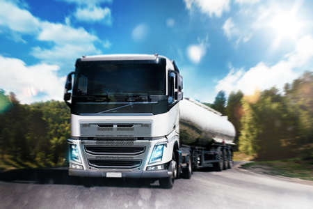 hauling: Transport truck on road with natural landscape Stock Photo