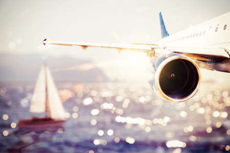 globetrotter: Plane flies over the sea with a boat Stock Photo