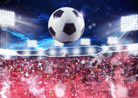 soccer team: Soccer ball with backgrounds fans in the stadium