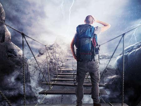 3D Rendering of explorer walks over a crumbling bridge Stockfoto