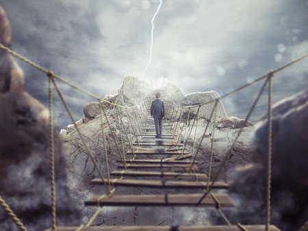 dangerous: 3D Rendering of man walks over a crumbling bridge Stock Photo