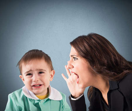 scold: Woman screaming to a crying baby boy