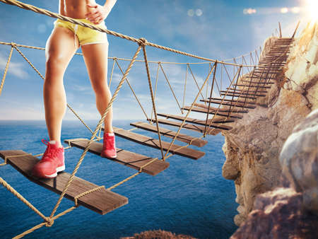 traverse: 3D Rendering of woman walks on a crumbling bridge Stock Photo