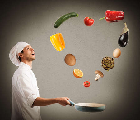 creates: Surprised chef creates a heart jumping on pan vegetables
