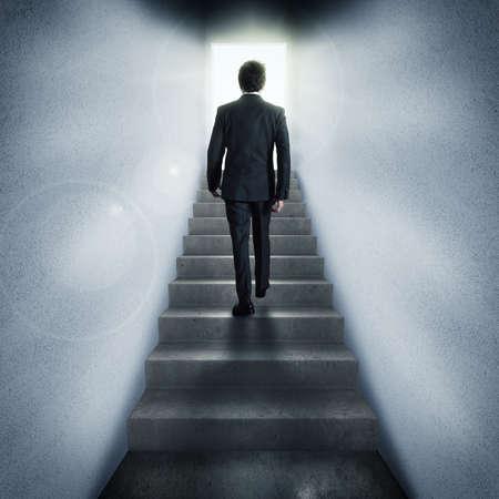 aspirational: Businessman climbs stairs to a passage lit