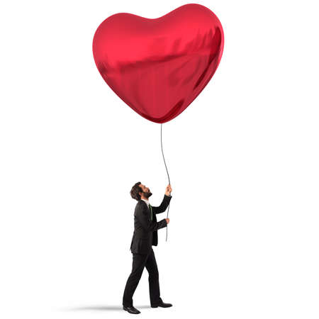 Man holds a big red heart balloon Stock Photo