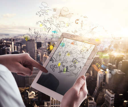 Man touches the tablet with background cityscape