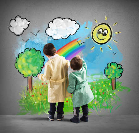 draw: Children draw on the wall a colorful landscape