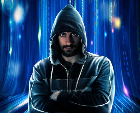 stolen data: Mysterious man with hoodie and blue lights background