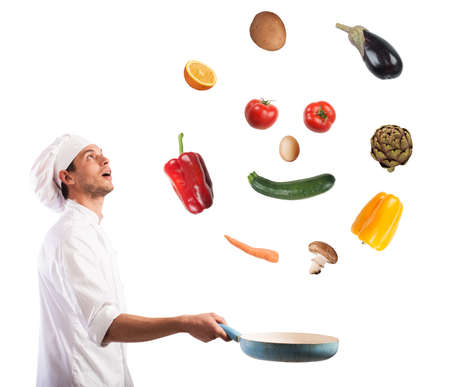 creates: Surprised chef creates a smile jumping on pan vegetables