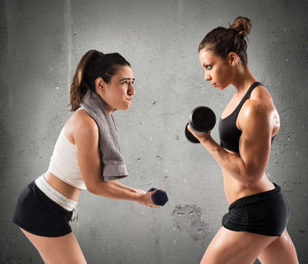 clumsy: Muscular girl trains with a clumsy girl