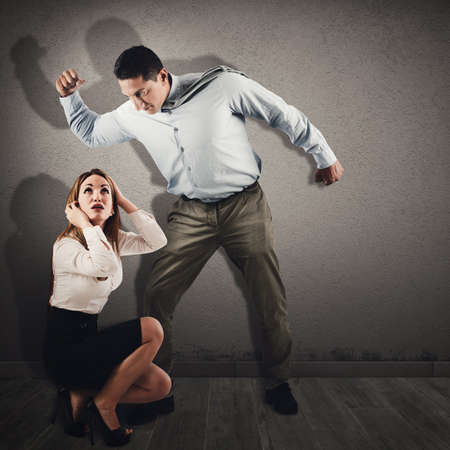 reproach: Violent and angry man intimidates a frightened woman