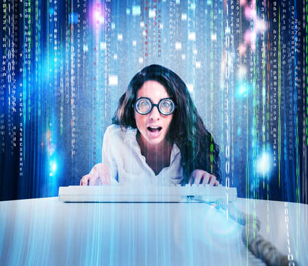cryptic: Woman with astonished expression and eyeglasses with computer keyboard