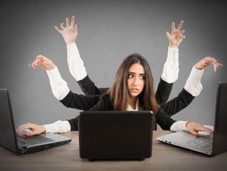 Woman with many arms working with three laptops