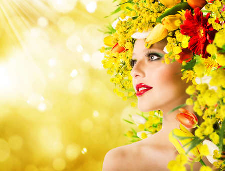 Modell mit Frisur mit Blumen und Make-up