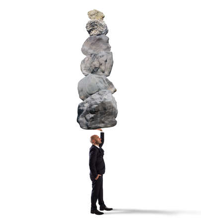 Businessman holds in one hand boulders stack