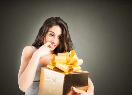 eager: Woman eager to open a big gift
