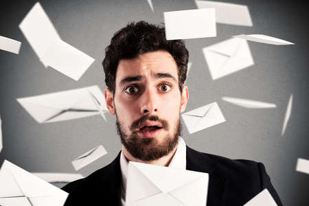 missive: Businessman with astonished expression with letters on background