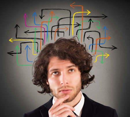 incertitude: Man with a questioning expression and design of arrows over his head Stock Photo