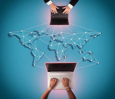 international internet: Men writes at computer with world map