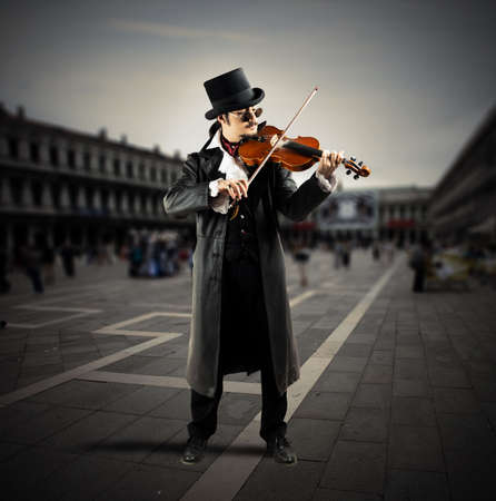 solo violinist: Violinist plays on a square with people walking