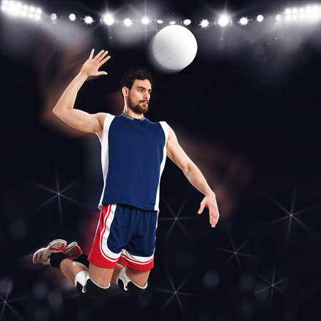 Jumping volleyball player ready to beat ball Stock Photo