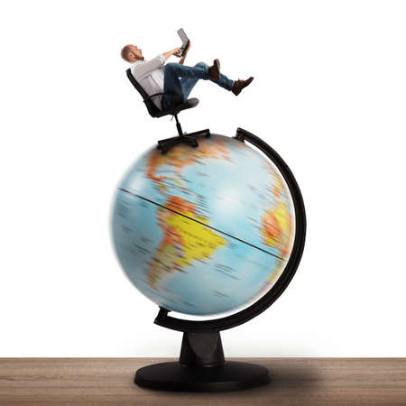 Man at computer over a globe spinning