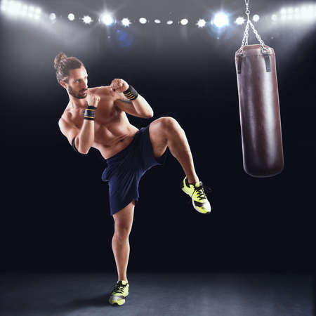 agility people: Man is training with the punching bag on gym