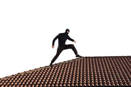apartment: Thief dressed in black walking on the roof of a house