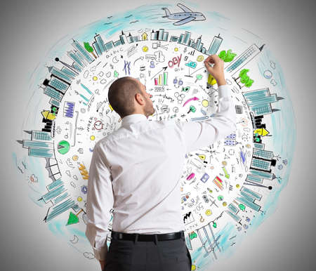 network people: Businessman draws on the wall of business projects Stock Photo