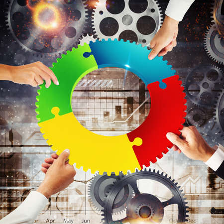 merging together: Business people join the colorful puzzle pieces of a gear. Concept of teamwork and integration. 3D Rendering