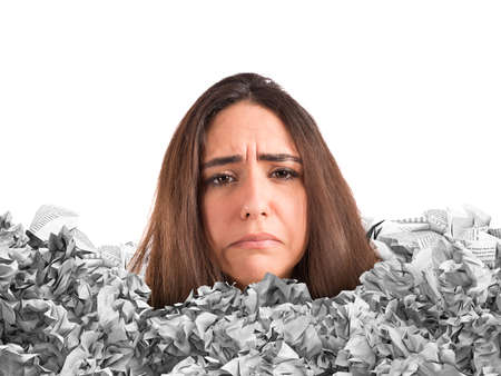 disarray: Sad woman trapped in a mountain of paperwork