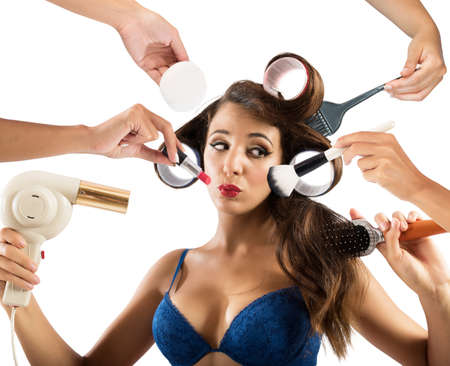 Girl gets her make-up and hair styled Stock Photo