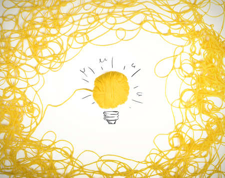 yellow fleece: Concept of idea and innovation with tangle of wool yarn Stock Photo