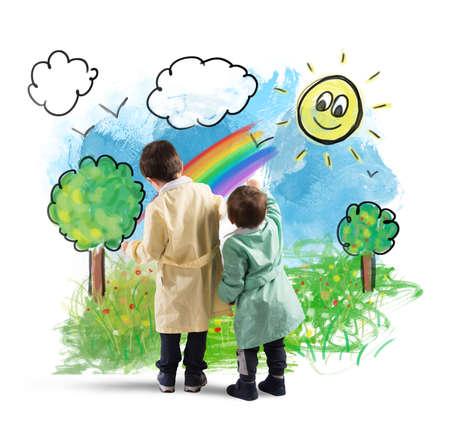 arcoiris: Los niños dibujan en la pared de un paisaje colorido Foto de archivo
