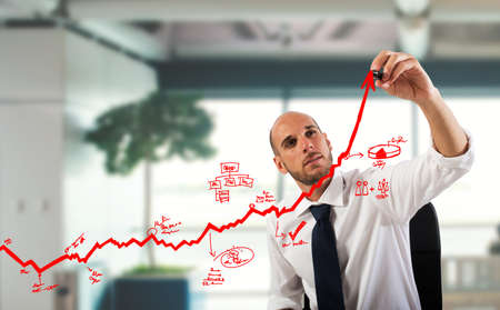 Businessman draw graphics on an arrow uphill Stok Fotoğraf