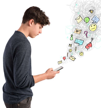 Teen boy writes on screen of his cellphone