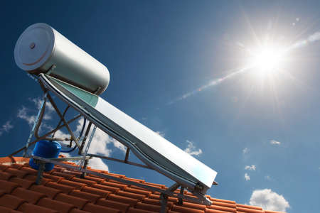thermal: Solar panel with water tank on the roof of a house Stock Photo