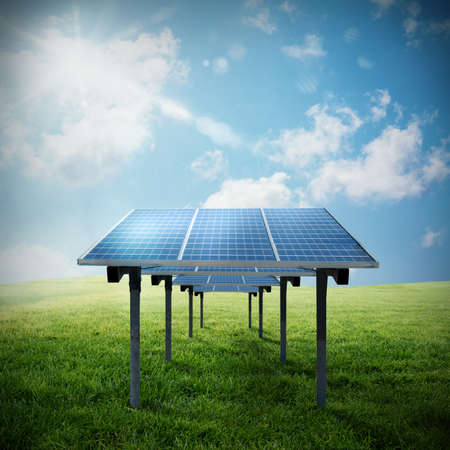 Solar panel in a field with the sky and the sun Banco de Imagens