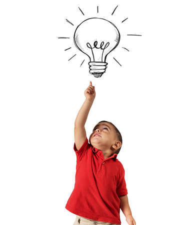 Child points a lightbulb drawn above his head Stock Photo