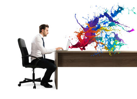 Concept of creative business with businessman working with laptop on the desk