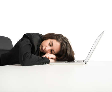 overwork: Woman exhausted from overwork sleeping over computer Stock Photo