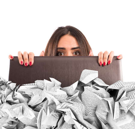 missive: Businesswoman hidden behind the laptop screen submerged by the sheets Stock Photo