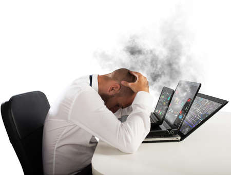 frustrate: Businessman with worried expression with computers in smoke