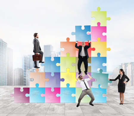 growing partnership: Team holds a puzzle as a scale to climb a man