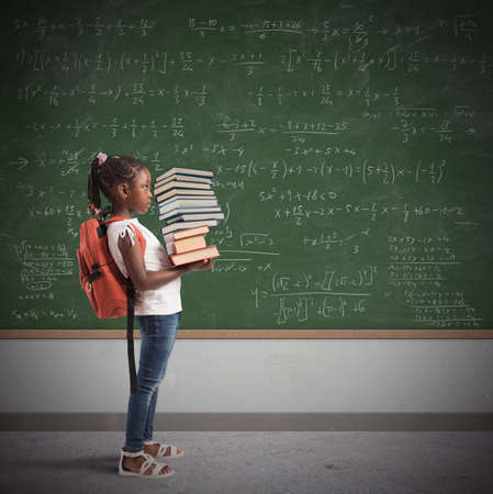 algebraic: Child with backpack and a study books pile with blackboard background
