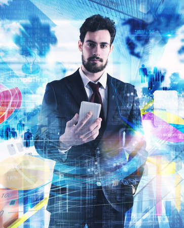Businessman with city and graphs with market analysis on background Stock Photo