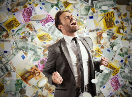 Concept of success and career of a businessman with rainy banknotes Foto de archivo