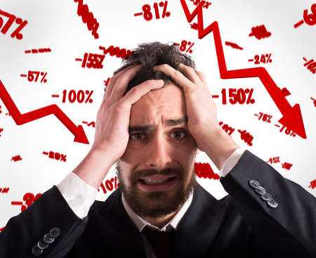 discouraged: Desperate and discouraged businessman with rates falling background